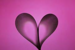 Hjärta på abstrakt rosa lutningbakgrund Fotografering för Bildbyråer