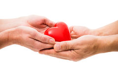 Hjärta på de mänskliga händerna Arkivbild
