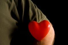Hjärta på en muff Royaltyfri Foto