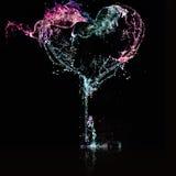 hjärtafärgstänkvatten Arkivbilder