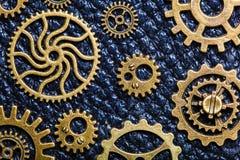 Hjul för Steampunk mekaniska kuggekugghjul på läderbakgrund Arkivfoto