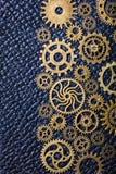 Hjul för Steampunk mekaniska kuggekugghjul på läderbakgrund Arkivfoton