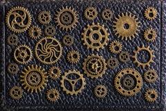 Hjul för Steampunk mekaniska kuggekugghjul på leathern bakgrund Royaltyfria Bilder
