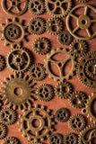 Hjul för Steampunk mekaniska kuggekugghjul på träbakgrund Fotografering för Bildbyråer
