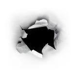 Hål i papper Fotografering för Bildbyråer