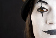 Half a Clown Face Brown Eyed Woman White Makeup Stock Photography