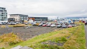 Hlesgata street near harbor in Reykjavik city. REYKJAVIC, ICELAND - SEPTEMBER 5, 2017: people and car parking on Hlesgata street near harbor in Reykjavik city in Royalty Free Stock Image