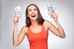 Hållande dollarräkningar för kvinna Arkivfoton