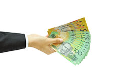 Hållande pengar för hand - australiska dollar Royaltyfria Foton
