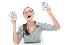 Hållande pengar för upphetsad kvinna Royaltyfria Bilder