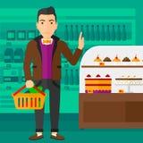 Hållande supermarketkorg för man Arkivfoton