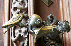 Hluboka nad Vltavou, Czech Republic, September 26 2014. Door handle at the entrance in Hluboka nad Vltavou castle. Arms of House of Schwarzenberg in the royalty free stock images