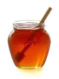 Hölzerner Schöpflöffel mit Glas Honig. Lizenzfreie Stockbilder