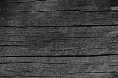 Hölzernes Planken-Brett-Grey Black Wood Tar Paint-Beschaffenheits-Detail, große alte gealterte dunkle Gray Detailed Cracked Timbe Stockfoto