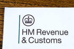 HM Revenue and Customs. LONDON, UK - JANUARY 13TH 2017: The logo of Her Majestys Revneue and Customs on a piece of paper, on 13th January 2017.  HMRC is a non Royalty Free Stock Images