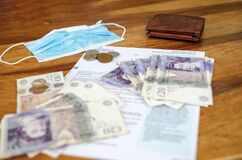 Free HM Revenue UK Papers For Self Employed With Sterling Pounds Money, Wallet And Mask During Coronavirus Lockdown. COVID-19 Royalty Free Stock Photos - 183443648