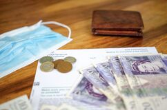 Free HM Revenue UK Papers Tax For Self Employed With Sterling Pounds Money, Wallet And Mask During Coronavirus Lockdown. COVID-19 Stock Photography - 183443652