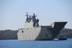 HMAS ADELAIDE. Sydney, Australia - April 27th, 2016: HMAS Adelaide coming into her home port of Sydney harbour Australia. Along with its sister ship, the stock image