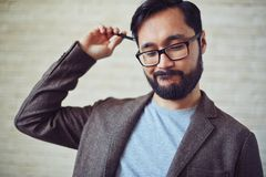 Hmm. Handsome businessman in eyeglasses doubting about something Royalty Free Stock Photography