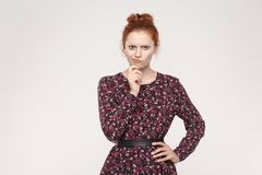 Free Hmm. Isolaited Studio Shot On Gray Background Of Cute Redhead Wo Stock Photography - 106298572