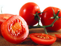 Hmmmm... wanna have some?. Sliced, juicy tomatoe on wooden plate Stock Image