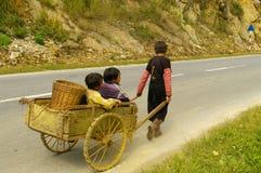 Hmong flower children leaving for work Royalty Free Stock Photos