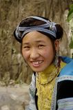 Hmong Girl Blue. Hmong girl returning from the blue Gathering herbs for cooking Stock Image