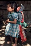 Hmong girl carrying baby Stock Photos