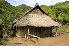 A Hmong hill tribe village in northern Laos. Typical poor village and thatched huts Royalty Free Stock Image