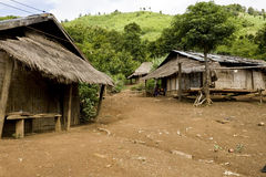 A Hmong hill tribe village in northern Laos. Typical poor village and thatched huts Royalty Free Stock Photos