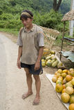 Hmong man in Laos with grape container Royalty Free Stock Images