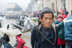 Hmong man in Sapa, Vietnam. Sapa, Vietnam - February 13, 2015: Hmong man at a market in Sapa. Sapa is famous for its rugged scenery and its rich cultural stock photo