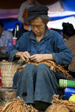 Hmong man at a weekly flea market Royalty Free Stock Image