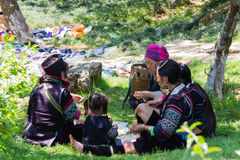 Hmong minority people in a family. A lunch too late in Ham Rong mountain, Sapa, Lao Cai, Viet Nam. Go and see the Tet holiday in Viet Nam Royalty Free Stock Photos