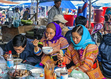 Hmong people eating on Sunday market. Royalty Free Stock Photography