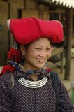 Hmong redwoman. Woman of the ethnic (minority) Hmong red pompoms. This beautiful woman is the traditional clothing of his tribe and the headdress of married Royalty Free Stock Photo