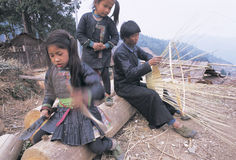 Hmong  in southwest  China. A   working  Hmong man   and his daughters, in  Guizhou,China Stock Image