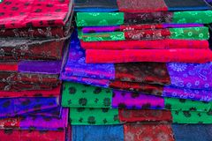 Hmong traditional fabrics on a market stall in Ha Giang Province, Northern Vietnam stock images