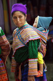 Hmong tribe woman carrying her child, Bac Ha, Vietnam Royalty Free Stock Images