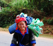 A Hmong woman on the rural road at Sapa town, northern Vietnam stock images