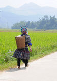 A Hmong woman walking on road at Tu Le town in Yen Bai, Vietnam Royalty Free Stock Images