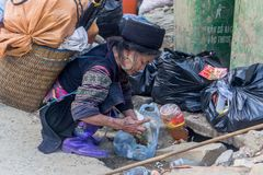 Hmong woman working in market in Sapa, Vietnam royalty free stock images