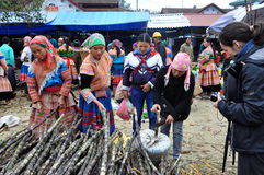 Hmong women selling sugar cane in Bac Ha market, Vietnam Stock Photo