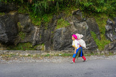 Hmong women selling vegetables on street Stock Photography