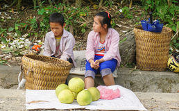 Hmong women selling vegetables on street Royalty Free Stock Photos