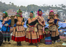 Hmong women in traditional dress on Sunday market in Bac Ha. Stock Photos
