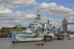 HMS Belfast. Moored on the River Thames by Tower Bridge royalty free stock photos