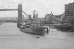 HMS Belfast Battleship - London. HMS Belfast Battleship on the Thames River in front of London Bridge in London Stock Photography