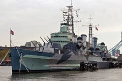HMS Belfast (C35) a Royal Navy light cruiser on the River Thames Royalty Free Stock Photo