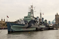 HMS Belfast (C35) a Royal Navy light cruiser on the River Thames Stock Image